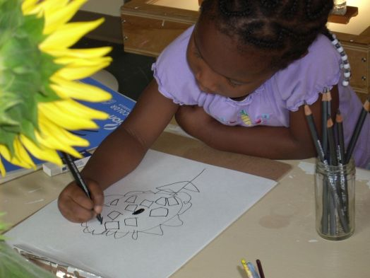 Child-Drawing-a-Sunflower